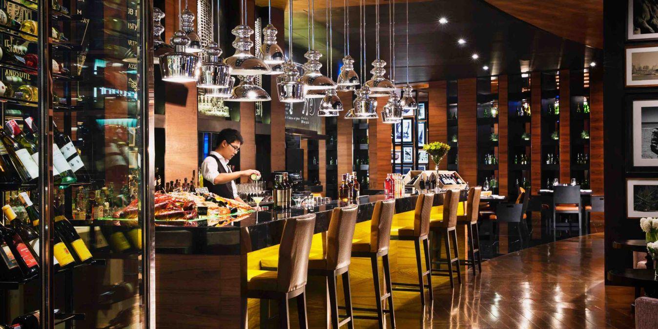 The District Grill Room & Bar, 57 Sukhumvit Rd, Khlong Tan Nuea, Watthana, Bangkok 10110, Thaïlande.